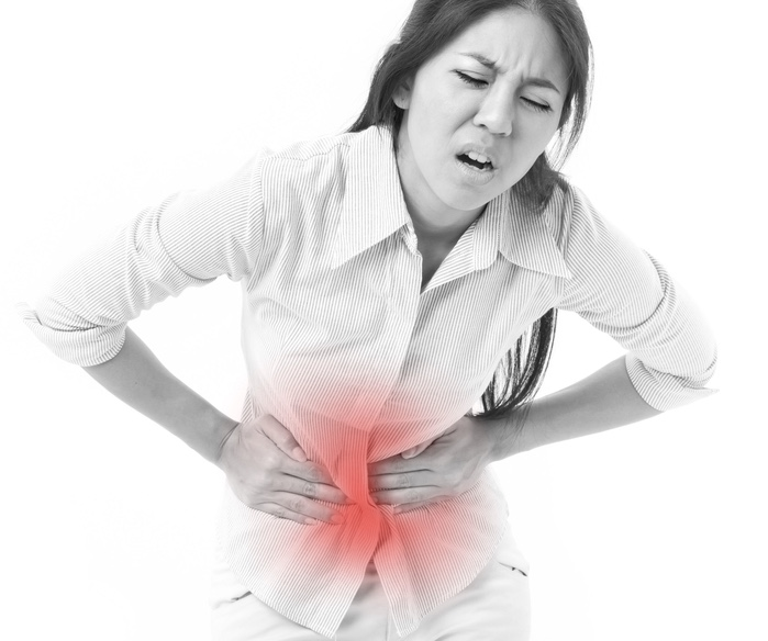 Woman Holding Tummy In Pain